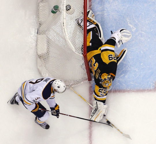 Pittsburgh Penguins goalie Marc-Andre Fleury (29) blocks a shot by Buffalo Sabres' Evander Kane (9) in the third period of an NHL hockey game in Pittsburgh, Sunday, March 5, 2017. The Penguins won 4-3. (AP Photo/Gene J. Puskar)