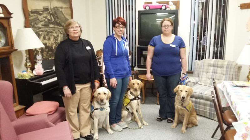 MEETING HIGHLIGHT — Representatives of Canine Companions for Independence were the guest  speakers at the March meeting of the GFWC Woman's Club of Mingo Junction, including, from left, Mary Ann Costantini with CCI graduate dog Young; Krystal Culler, puppy raiser with dog Brandon; and Susan Costantini, puppy raiser with dog Guru. -- Contributed