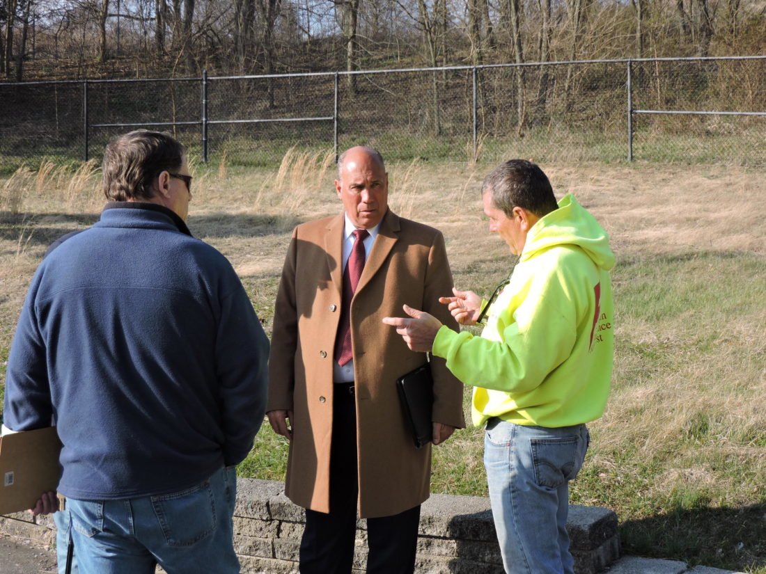 Steubenville Streets and Sanitation Superintendent Bob Baird, left, and City Manager Jim Mavromatis, center, listened to Jim Saltsman of Fort Steuben Maintenance during a Tuesday afternoon tour of the Belleview Pool. City Council is considering a proposal by Mavromatis to keep the swimming pool closed this summer for renovations. — Dave Gossett