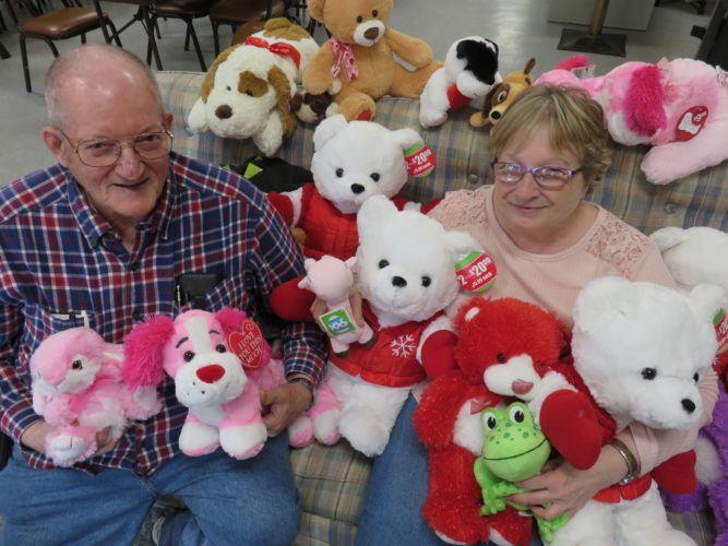 THEMORETHEMERRIER — Breast cancer survivor Diane Pernick and her husband, Fred, hold some of the stuffed animals being collected until after Easter at the Mingo Senior Center for donation to patients at the Children Cancer Center at Children's Hospital in Pittsburgh. -- Janice Kiaski