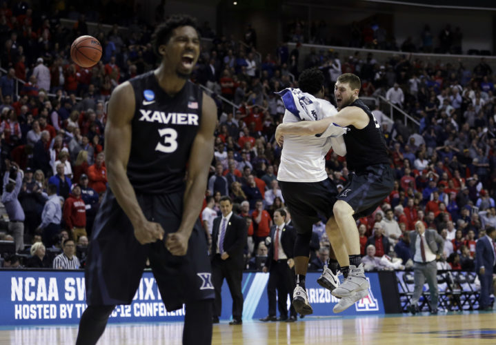Xavier players including Sean O'Mara, right, and Quentin Goodin (3) celebrate after beating Arizona during an NCAA Tournament college basketball regional semifinal game Thursday, March 23, 2017, in San Jose, Calif. (AP Photo/Ben Margot)