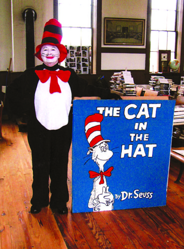 """'PURR-FECT' OUTFIT — Connie Crawford, a member of the Pleasant Hill Historical School House Museum, poses in her """"Cat in the Hat"""" outfit she'll wear to greet patrons attending the organization's book sale to be held from 10 a.m. to 2 p.m. April 8 at the museum, which is located at 3125 state Route 213, Steubenville. -- Contributed"""