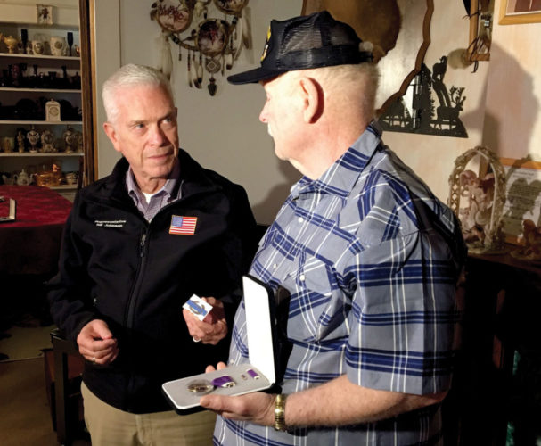 MEDALS  PRESENTED — U.S. Rep. Bill Johnson, R-Marietta, left, presents the Combat Infantryman Badge to Vietnam War veteran Joseph Brown Monday. Brown holds his Purple Heart. - Steve Rappach