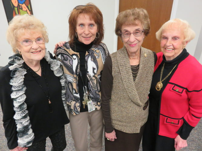 SAYINGGOODBYE — Glenda Fordyce, second from left, retired as manager of the now closed Tree House Gift Shop at Trinity Health System East and was visited by several longtime volunteers during a reception held in her honor. They included Marge Bedortha, left; Mary Filler, third from left; and Eleanor Weiss, right. -- Janice Kiaski
