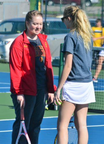 Mike Mathison TENNIS ANYONE? — The Redskins' Madison Legros, right, and teammate Alyssa Campbell talk during a break in their match. (Mike Mathison)
