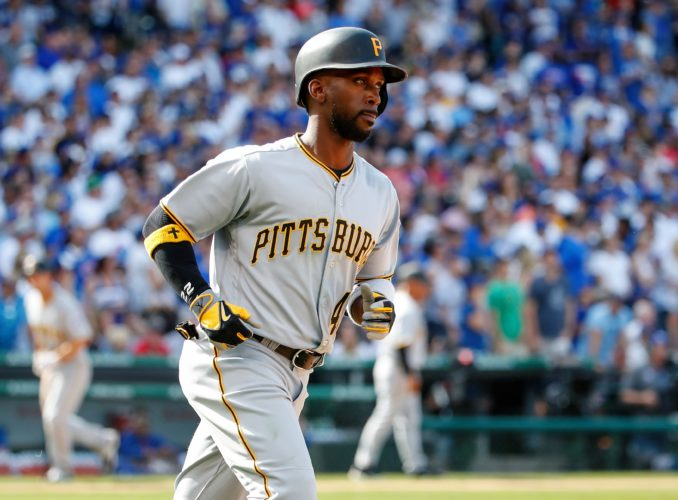 Pittsburgh Pirates' Andrew McCutchen rounds the bases after hitting a three-run home run off Chicago Cubs relief pitcher Pedro Strop during the seventh inning of a baseball game, Saturday, April 15, 2017, in Chicago. Adam Frazier and Starling Marte also scored on the play. (AP Photo/Kamil Krzaczynski)