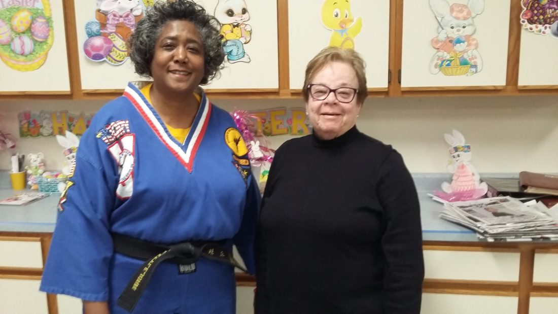 MEETING LEADERS —  Janet Petrella, right, president of the GFWC Woman's Club of Mingo Junction welcomed Vicki Littlejohn, part of the family-owned business Academy of Tae Kwon Do in Wintersville, as the guest speaker at the April meeting.  -- Contributed