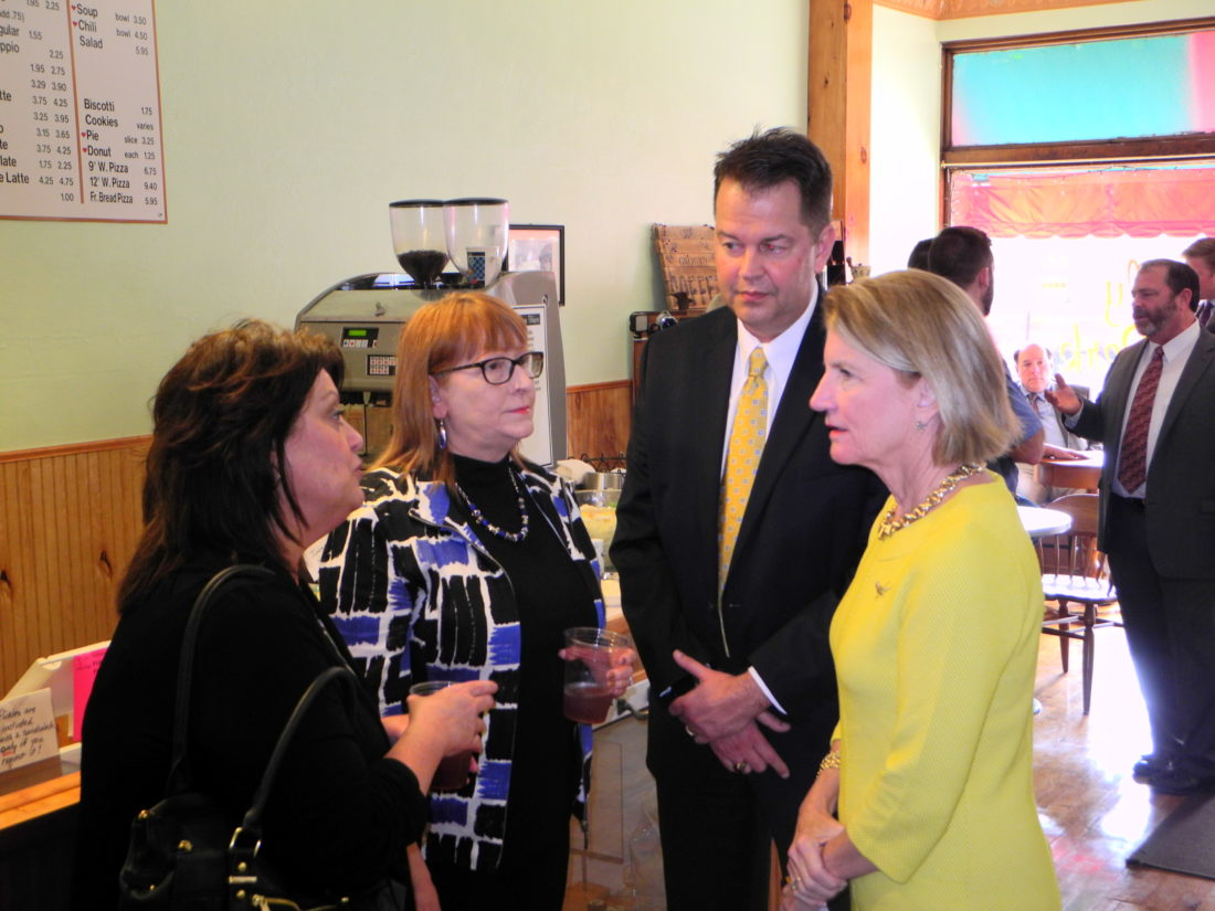VISITSFOLLANSBEE — U.S. Sen. Shelley Moore Capito, R-W.Va., far right, chatted with local residents, business leaders and officials, during a visit to the Daily Perk coffee shop and the Follansbee City Building Wednesday. With her are Cindy Kocher, Debbie Puskarich and Mayor David Velegol Jr. - Warren Scott