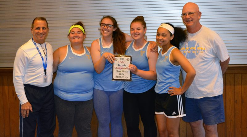 TAKING SECOND — Oak Glen poses with the OVAC Class 1A-4A runnerup trophy Tuesday in Wheeling. From left, tournament director George Frazier, Molly Swartzmiller, Brooke Provenzano, Katie Szymanski, Cristal Tetrault and Coach Ken Keller. Also on the team are Ally Brothers and Abby Chavez. -- Josh Strope