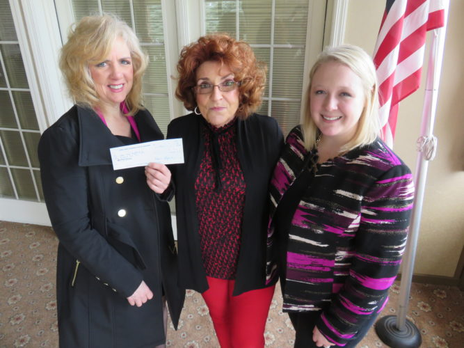 SPIRIT OF GIVING — On behalf of the OFWC-GFWC Woman's Club of Steubenville, Iris Craig, center, president, presented two checks for $1,000 at the club's April meeting. One went to the Ohio Valley Health Center, which was accepted by board President Francesca Carinci, left, and the other to the United Way of Jefferson County, accepted by Kate Sedgmer, its executive director.  -- Janice Kiaski