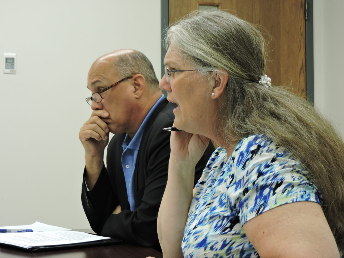 CODEDISCUSSION — Steubenville City Manager Jim Mavromatis listened while Councilwoman at large Kimberly Hahn explained why she called for a property maintenance code workshop Wednesday afternoon. - Dave Gossett