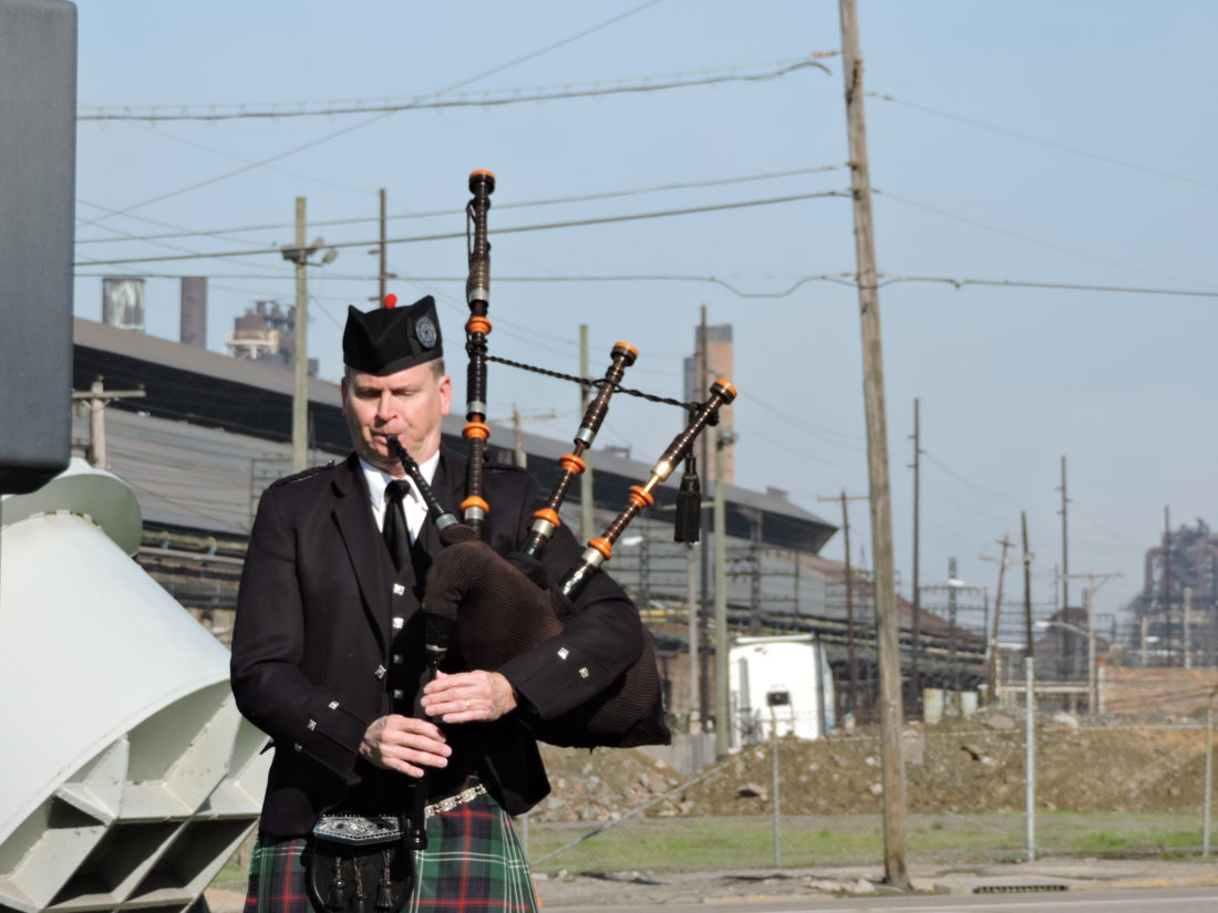 OPENING THE CEREMONY — Stephen Holter played his bagpipes Friday morning at the beginning of the Steelworkers Memorial Day ceremony with the steel mill facilities behind him. The service remembered the 119 steelworkers who died while working in the mill from 1919 to 1999. - Dave Gossett