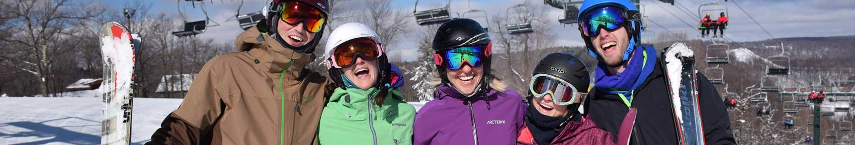young-adults-smiling-on-the-slopes