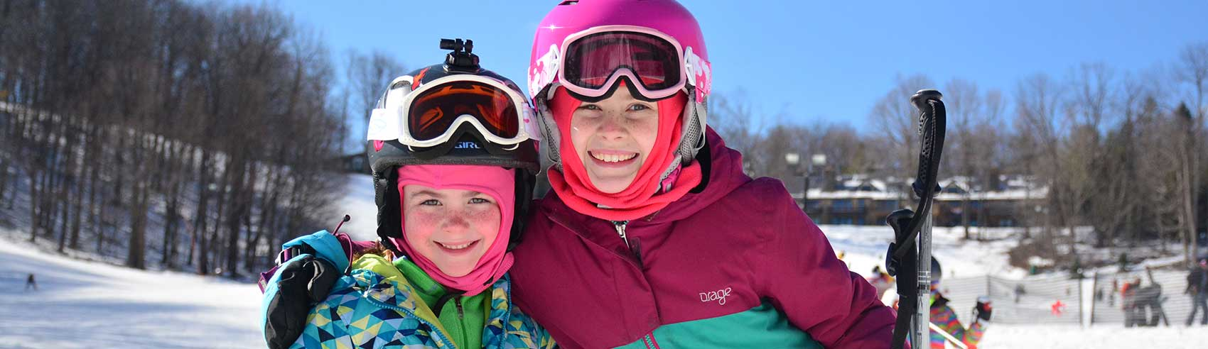 smiling-kids-ready-to-ski