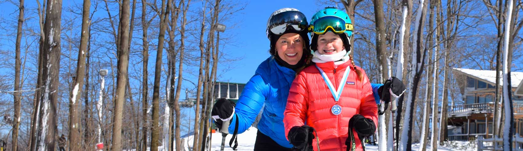 mom-and-daughter-on-the-slopes