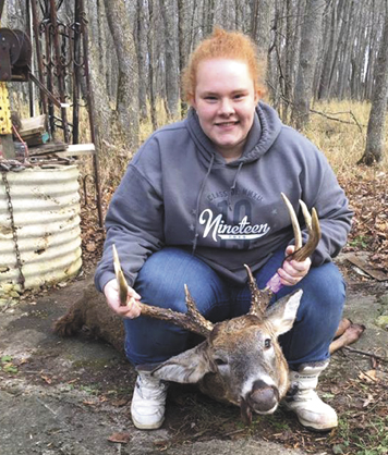 Tianna Fiorucci, of Kingsford, shot this 200-pound 8-pointer with an 18.5-inch spread at 6:57 a.m. Tuesday while hunting with her papa, Jim Christensen, at Camp Titanic II, located in Menominee County.