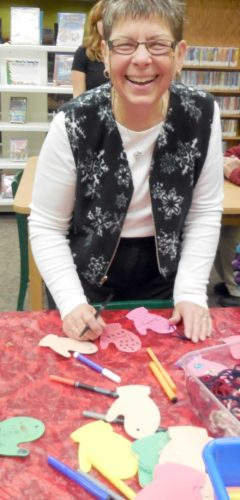 Linda Dufresne makes ornaments at the Dickinson County Library.