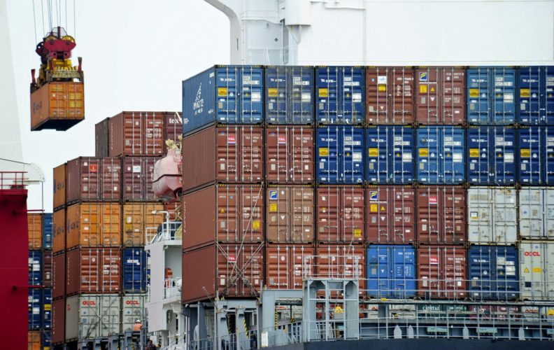 A CONTAINER IS loaded onto a cargo ship at the Tianjin port in China. (AP File Photo)
