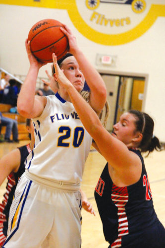 Kingsford's Hannah Carlson (20) shoots against Westwood on Friday. The Flivvers won, 45-41. (Adam Niemi/The Daily News)