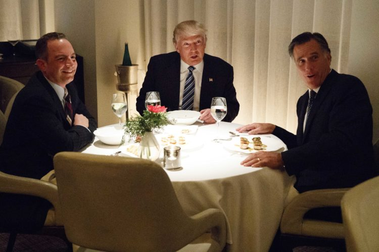 PRESIDENT-ELECT DONALD TRUMP, center, dines with Mitt Romney, right, and Trump Chief of Staff Reince Priebus at Jean-Georges restaurant Tuesday in New York. (AP Photo/Evan Vucci)