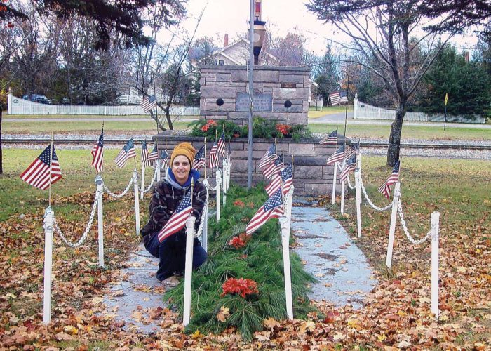 "Lynda Gurgall for the past 19 years has gotten the veterans marker ready for Veterans Day. The marker was erected in October 1972 by the local American Legion Post, and it reads ""dedicated to the men and women who served our country in war and peace."""