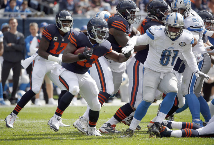 Desperate for depth in the backfield, the Detroit Lions brought back Joique Bell (shown with the Bears in October) after cutting him in February. They might need Bell to play Sunday against Chicago, which cut him last month. (AP Photo/Nam Y. Huh)