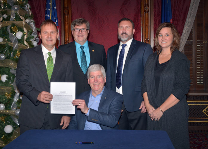 State Sen. Tom Casperson, R-Escanaba, (second left) joined Gov. Rick Snyder, Brian Swift (far left), Patti Dringoli (far right), and Sen. Phil Pavlov, R-St. Clair Township, (second right) for a special bill-signing ceremony at the Capitol on Tuesday. Senate Bill 434, now Public Act 243 of 2016, is known as the Barbara J. and Thomas J. Swift law, named after the late Escanaba couple who inspired the bill.