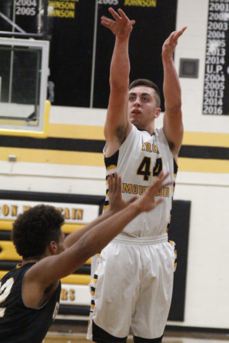 Iron Mountain's Carson Wonders shoots a three-pointer against Gwinn on Friday in Iron Mountain. Wonders made 12 triples in the 72-43 win, tying him for third place in the MHSAA record book for three-pointers made in one game. (Adam Niemi/The Daily News)