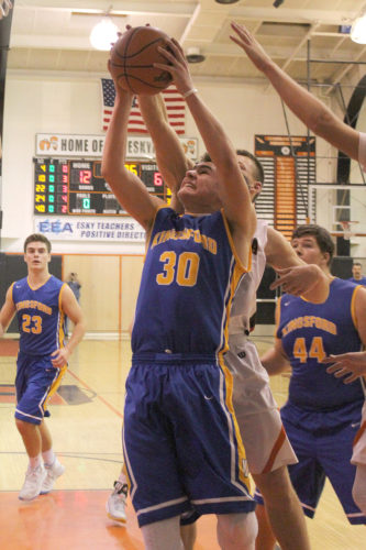 Kingsford's Tyler Beauchamp, center, scored a team-high 27 points. (Avery Bundgaard/The Daily Press)