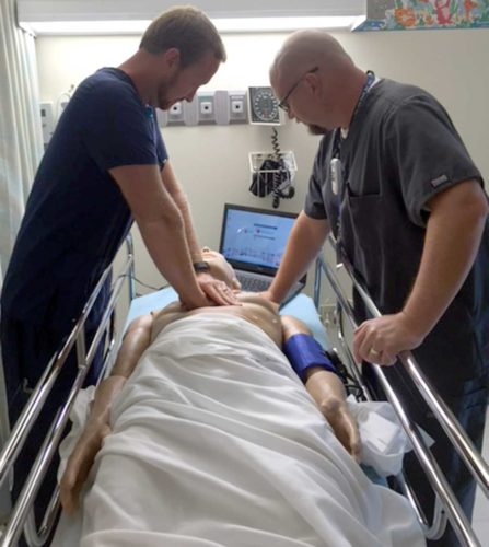 Pictured, from left, Dickinson County Healthcare System staff member, Andrew Gearhart BSN, RN, and Trenton Rankin BSN, RN, CEN – DCHS Manager of Inpatient Services, practice lifesaving techniques on HAL, a realistic, full body, computer operated, interactive simulator.