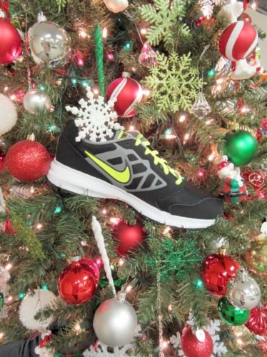 The tree at U.P. Rehab Services of Kingsford is decorated with sneakers, shown here, as the staff collects donations of athletic shoes and socks for children for Heart and Soles of 906. The office also is collecting donations for the Moving Mountains Adaptive Program from now through Jan. 1.