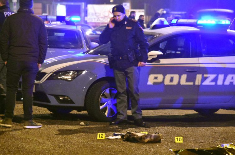 "AP Photo Italian police collect evidence after a shootout between police and a man near a train station in Milan's Sesto San Giovanni neighborhood, Italy, early Friday. Italy's interior minister Marco Minniti says the man killed in an early-hours shootout in Milan is ""without a shadow of doubt"" the Berlin Christmas market attacker Anis Amri."