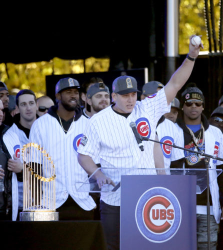 Cubs' first baseman Anthony Rizzo holds up the World Series final out ball during a Nov. 4 rally in Grant Park honoring the World Series championship in Chicago. The Cubs' first World Series title in 108 years punctuated a memorable year of sports moments. (Charles Rex Arbogast/AP File Photo)