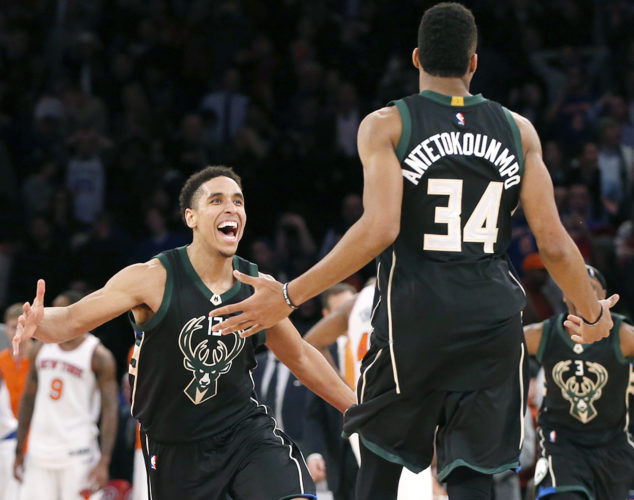 Milwaukee guard Malcolm Brogdon (13) reacts after teammate Giannis Antetokounmpo (34) hit a buzzer-beater to beat the New York Knicks 105-104 at Madison Square Garden in New York on Wednesday. (Kathy Willens/AP Photo)