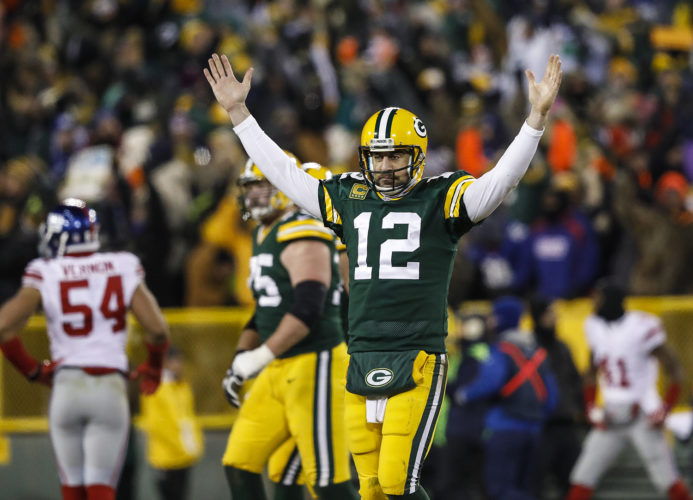 Green Bay quarterback Aaron Rodgers reacts after his touchdown pass to Randall Cobb on Sunday in Green Bay, Wis. (Jeffrey Phelps/AP Photo)
