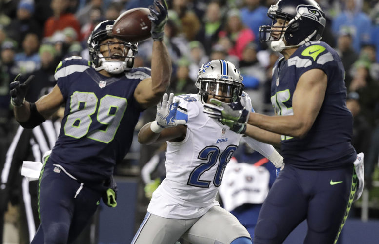 Seattle Seahawks wide receiver Doug Baldwin (89) makes a catch for a touchdown as Detroit Lions strong safety Don Carey (26) and wide receiver Jermaine Kearse, right, look on in the second half of an NFL football NFC wild card playoff game, Saturday, Jan. 7, 2017, in Seattle. (AP Photo/Elaine Thompson)