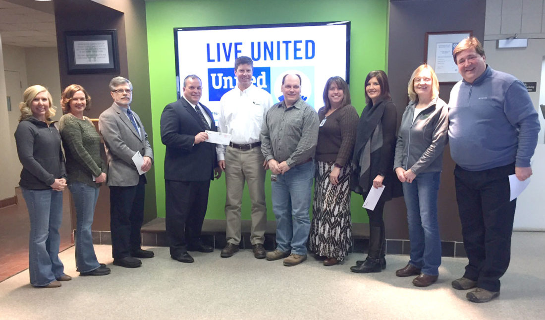 The employees of the Verso Quinnesec mill have made a donation to three area United Ways as a part of the 2017 campaign. Shown  here making the check presentations, from left, are Rachael Butler of Verso; Chrystal Maloney of Verso; Phil Everhart of the Tri-City Area United Way; Chuck Munk of the United Way of Dickinson County; Mike Glodowski, Verso mill manager; Brian LaBrash of Verso; Jennifer Anderson of United Way of Dickinson County; Debra Peterson of United Way of Dickinson County, Patrice Wartick of Verso; and Mark Pontti of Verso.