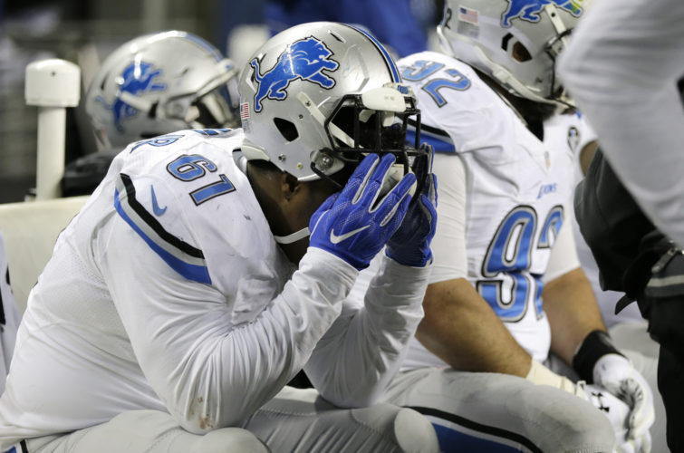 Lions defensive end Kerry Hyder sits on the bench at the end of the NFC wild card playoff game against the Seattle Seahawks last Saturday in Seattle. The Seahawks beat the Lions 26-6. (Stephen Brashear/AP Photo)