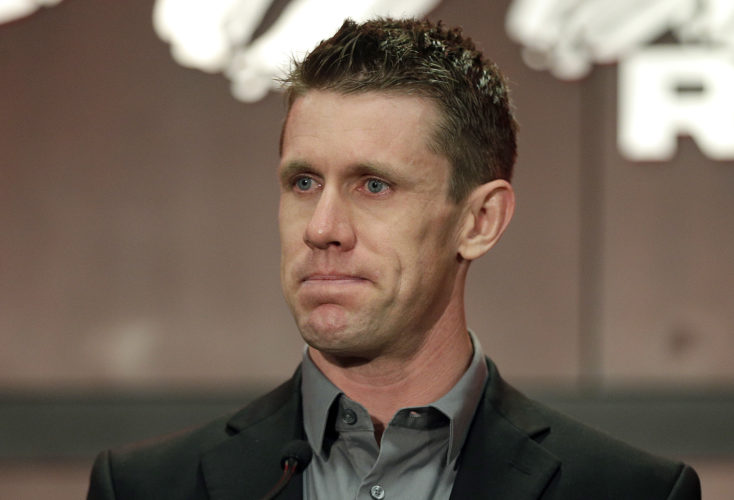 Carl Edwards pauses Wednesday in North Carolina as he announces he is stepping away from racing. (Chuck Burton/AP Photo)