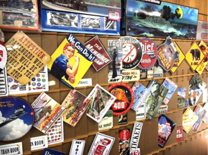 Tin signs are among the items for sale at Superior Hobby U.P., formerly Superior Carpet & Hobby in Iron Mountain. The business is closing the flooring warehouse and focusing on the hobby store.
