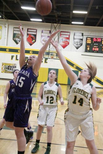 Niagara's Taylor Tushoski (15) battles Florence's Chloe Peterson (14) for a rebound as Savannah Vassar (12) looks on Tuesday in Florence, Wis. Niagara won 48-20. (Adam Niemi/The Daily News)