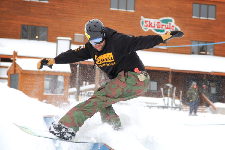 Nick Baumgartner grinds a rail in Iron River on Jan. 11. Baumgartner, 35, has competed in the previous two Winter Olympics. He said he plans to compete in two more. (Adam Niemi/The Daily News)