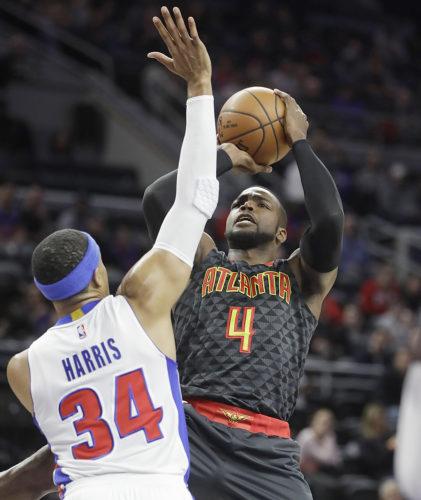 Atlanta Hawks forward Paul Millsap (4) shoots over Detroit Pistons forward Tobias Harris (34) on Wednesday in Auburn Hills, Mich. (AP Photo/Carlos Osorio)