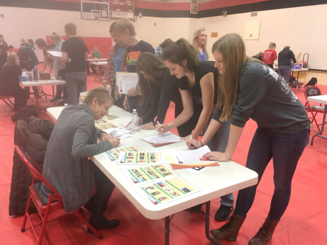 CoVantage Credit Union sponsored a reality fair at the Forest Park High School in Crystal Falls. Volunteer at left, Staria Syrjanen helps students, from left, Louis Olson, Riley Anderson, Emily Faccin, Becky Kolenda and Jenna Grabowski.