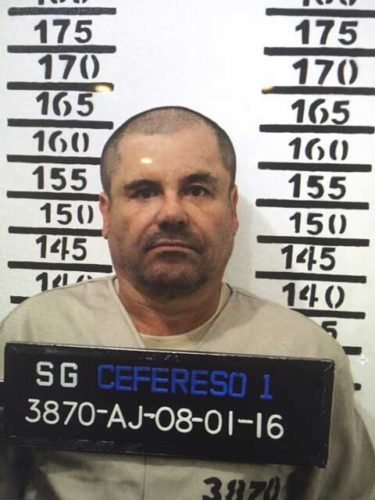 "In this PHOTO released by Mexico's federal government, Mexico's drug lord Joaquin ""El Chapo"" Guzman stands for his prison mug shot with the inmate number 3870 at the Altiplano maximum security federal prison in Almoloya, Mexico."