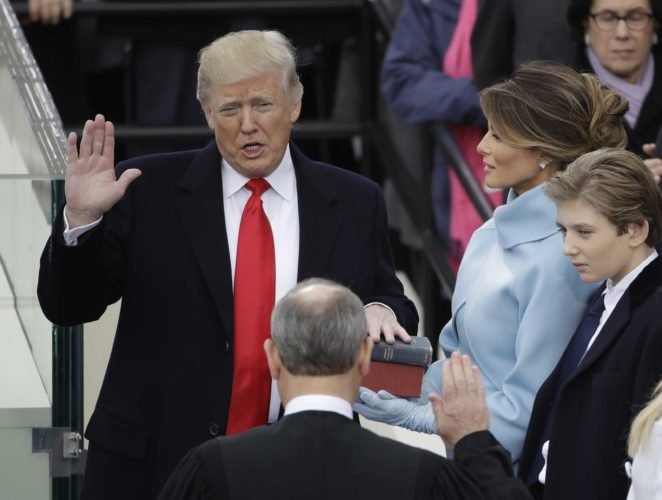 Donald Trump is sworn in as the 45th president of the United States by Chief Justice John Roberts as Melania Trump looks on during the 58th Presidential Inauguration at the U.S. Capitol in Washington. (AP Photo/Matt Rourke)