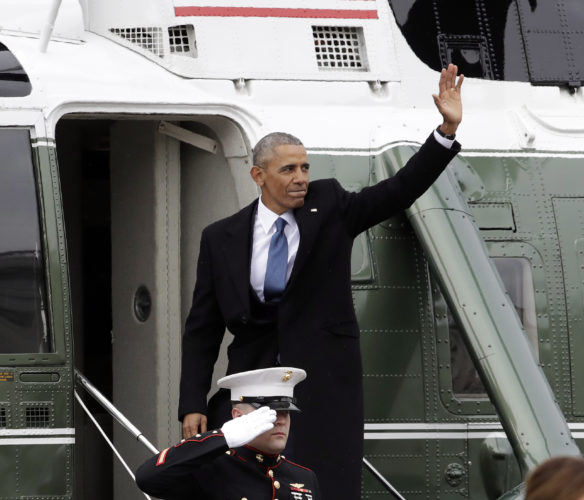 Former President Barack Obama waves as he boards a Marine helicopter during a departure ceremony on the East Front of the U.S. Capitol in Washington after President Donald Trump was inaugurated. (AP Photo/Evan Vucci)