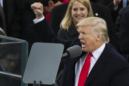 President Donald Trump pumps his first at the end of his speech after bring sworn in as the 45th president of the United States during the 58th Presidential Inauguration at the U.S. Capitol in Washington, Friday, Jan. 20, 2017. (AP Photo)