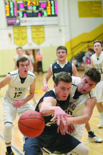 Negaunee High School's Darius Provost, front right, and Norway High School's Kevin Evosevich, front left, reach for the ball Thursday night, Jan. 19, 2017, at Lakeview Elementary School. Pictured in rear l-r: Jacob Ennett, Josh Plante, Trevor Uren. (Journal photo by Jess Makela)