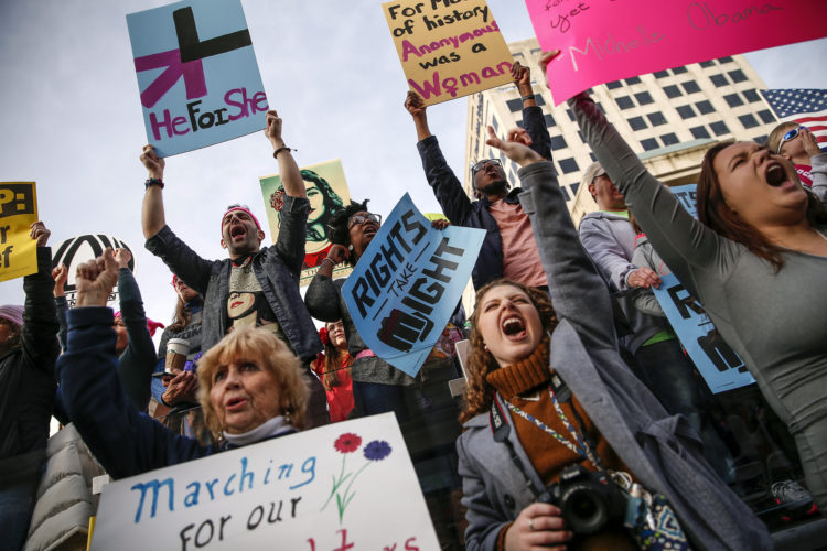 Thousands attend the Women's March Indianapolis rally, a sister rally of the Women's March on Washington, on the west side of the Indiana Statehouse in Indianapolis on Saturday, Jan. 21, 2017. ( Mykal McEldowney/The Indianapolis Star via AP)